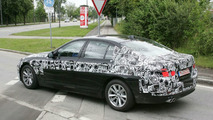 2011 BMW 5-Series sedan first time spied with psychedelic camouflage