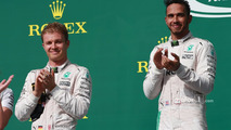 Second place Nico Rosberg, Mercedes AMG F1, race winner Lewis Hamilton, Mercedes AMG F1