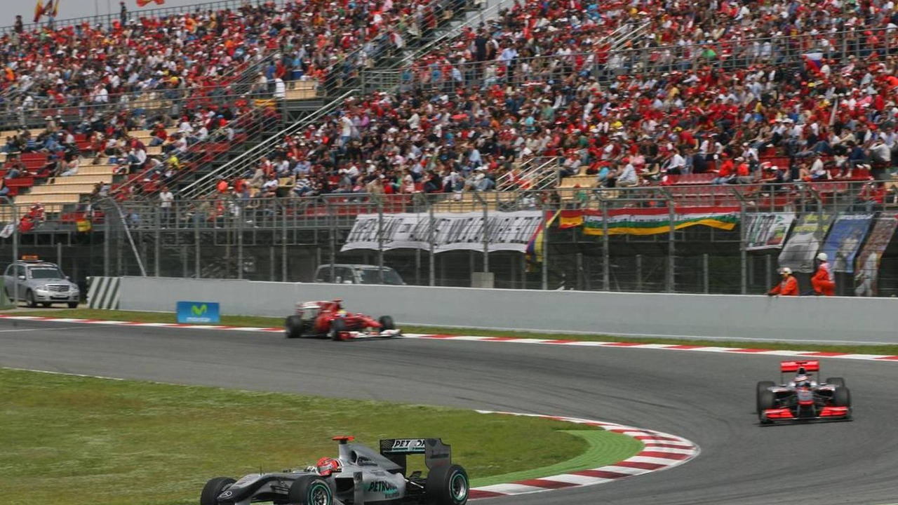 Michael Schumacher (GER) and Jenson Button (GBR), Spanish Grand Prix, 09.05.2010 Barcelona, Spain
