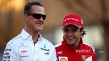 Michael Schumacher, Mercedes GP and Felipe Massa, Scuderia Ferrari