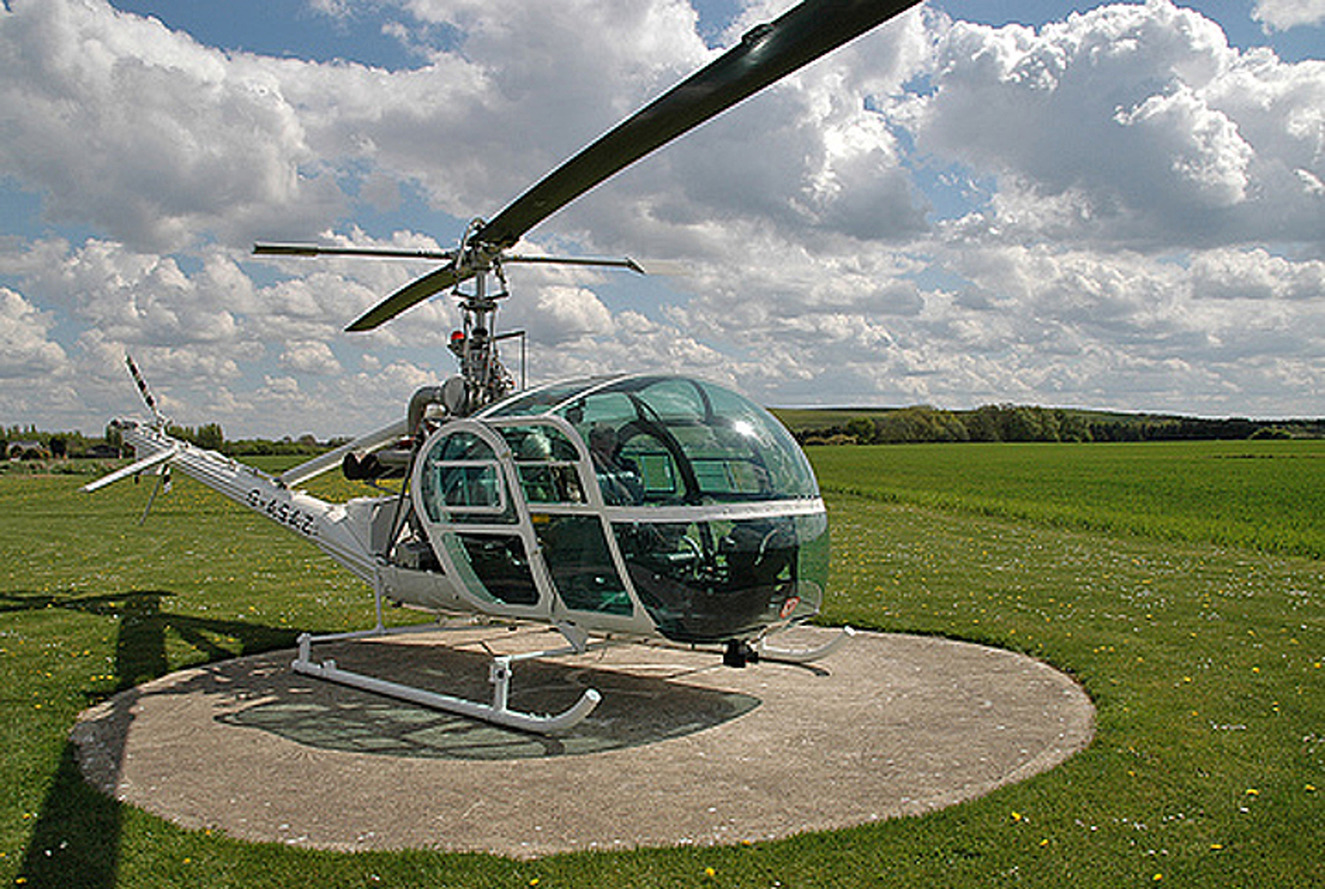 Famous Bond Helicopter Flies Into Goodwood Revival