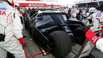 Batmobile Crosses Silverstone Tarmac Beside Toyota F1