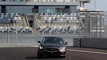 Sebastian Vettel laps Sochi GP circuit in an Infiniti Q50