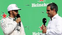 (L to R)- Lewis Hamilton, Mercedes AMG F1 on the podium with Juan Pablo Montoya