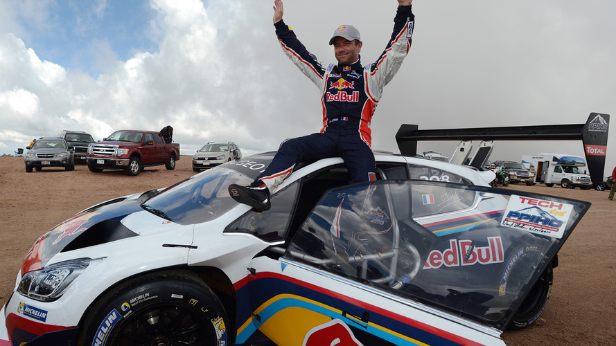 Winner Sébastien Loeb celebrates after breaking the record