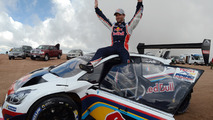Winner Sébastien Loeb celebrates after breaking the record