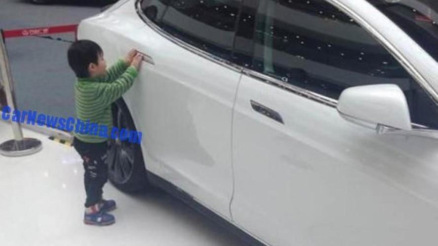 Five-year-old boy hits a baby with a Tesla Model S in Chinese mall
