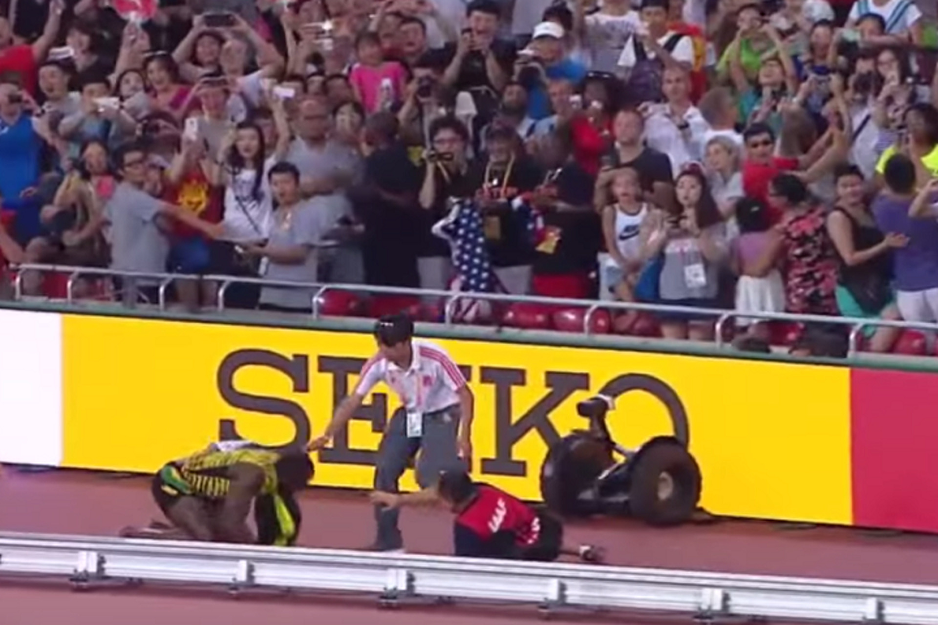Watch Usain Bolt Get Hit by a Cameraman on a Segway