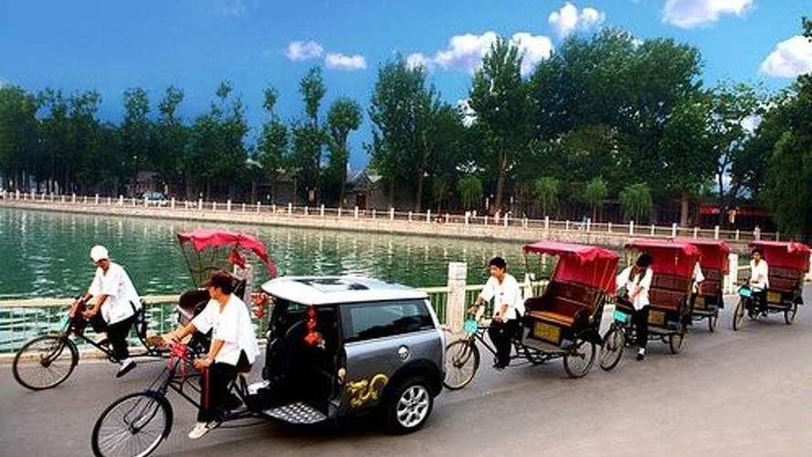 Mini Rick Shaw Taxiing Folks at Beijing Olympics