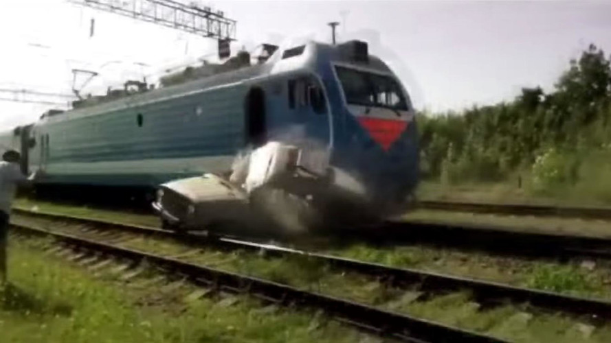 See This Driver Bail From An SUV As It's Smashed By Train