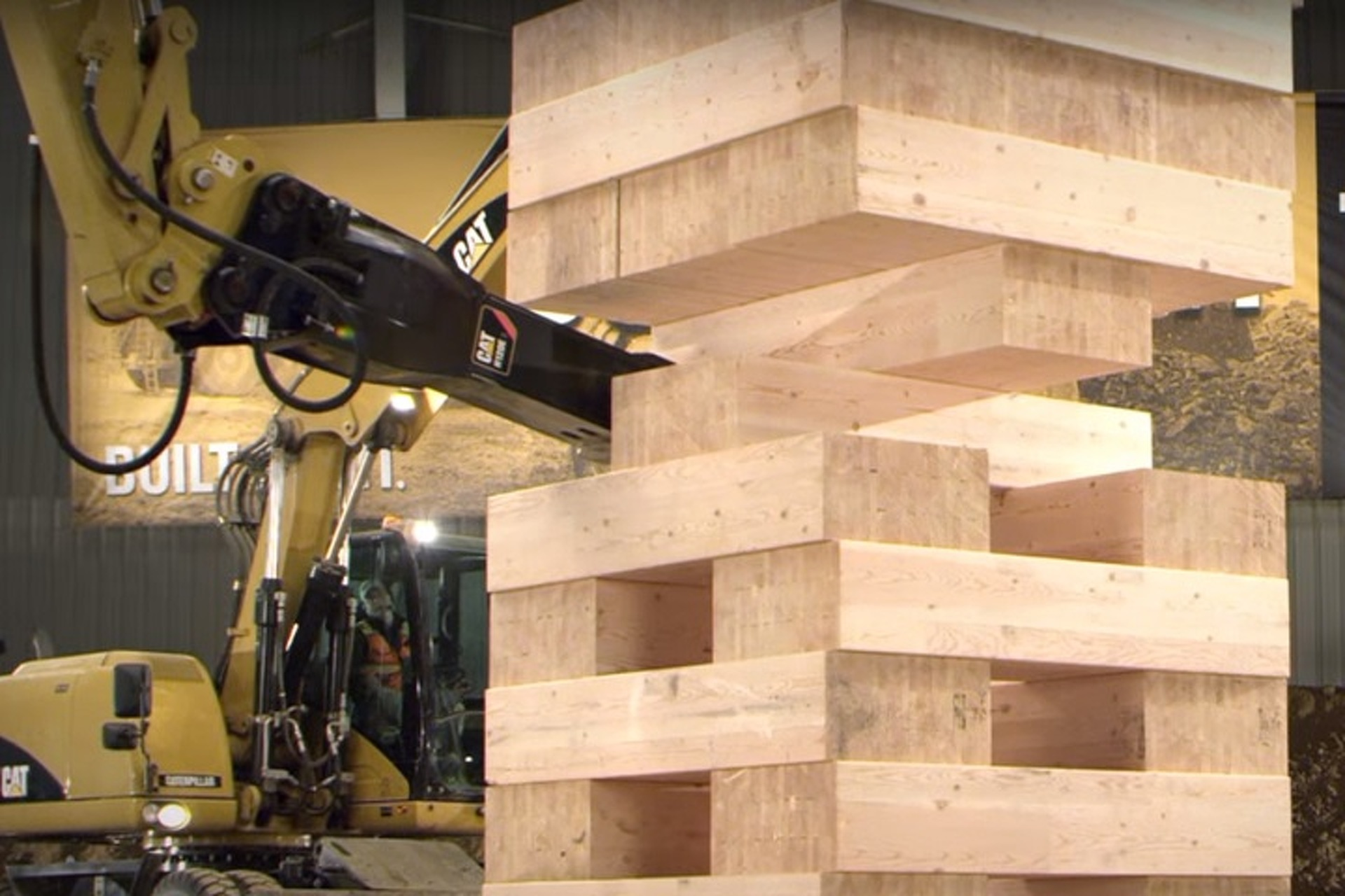 Watch a Game of Jenga Using Caterpillar Construction Vehicles